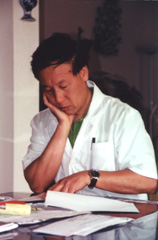 Mr. Gao studying a Chinese Medical text